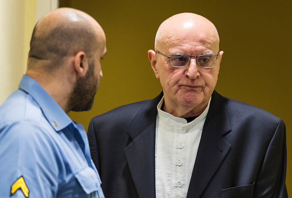 . FILE - In this Jan. 30, 2015 file picture Ljubisa Beara, right, enters the courtroom of the International Criminal Tribunal for the former Yugoslavia (ICTY) in The Hague, Netherlands. The Bosnian Serb commander convicted of war crimes over the 1995 Srebrenica massacre has died in a German prison. He was 77. A spokeswoman for Berlin state\'s justice department told The Associated Press on Friday Feb. 10, 2017 that Ljubisa Beara died Feb. 8.   (AP Photo/Michael Kooren, Pool, file )