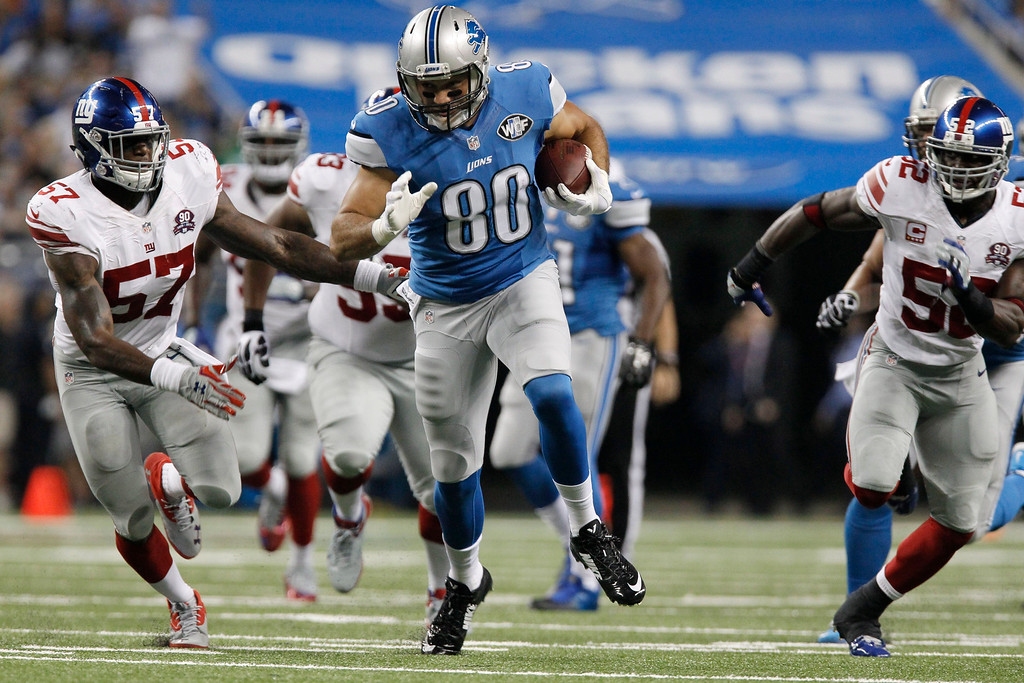 . Detroit Lions tight end Joseph Fauria (80) breaks for a 26-yard run during the third quarter of an NFL football game against the New York Giants in Detroit, Monday, Sept. 8, 2014. (AP Photo/Duane Burleson)