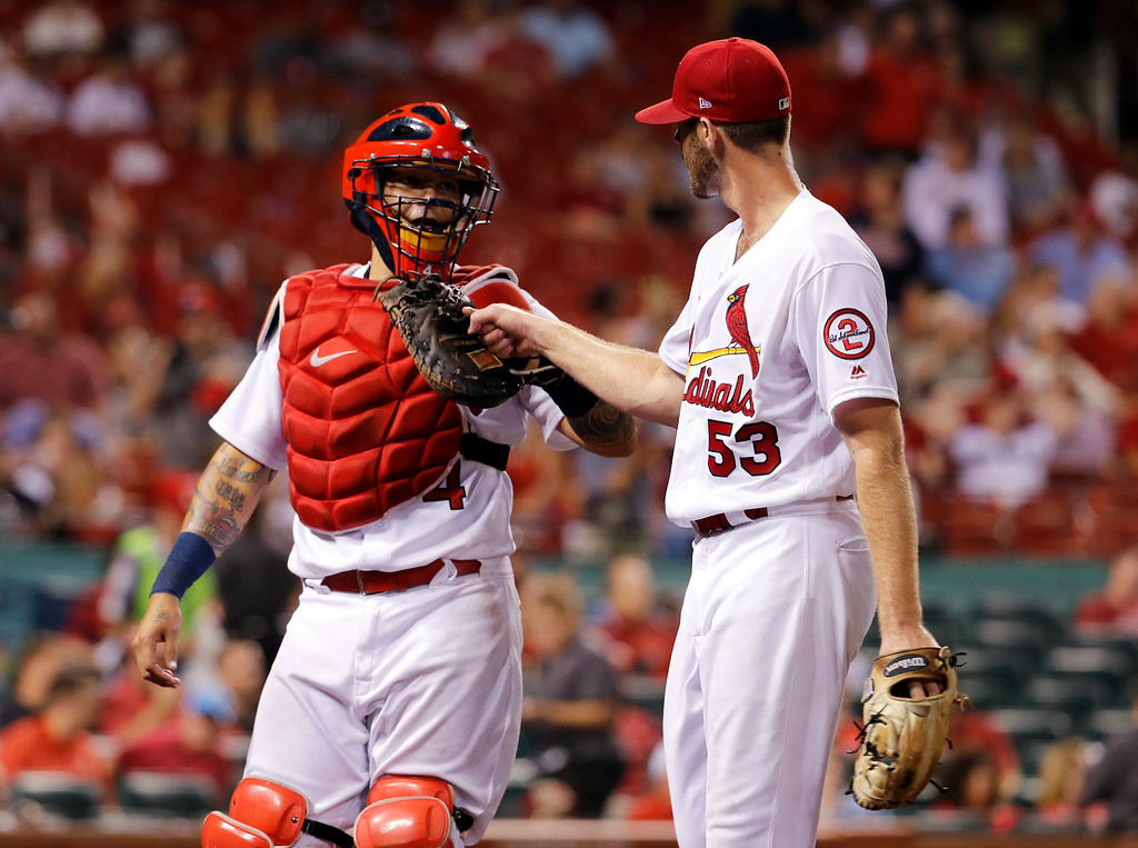 . St. Louis Cardinals starting pitcher John Gant, right, is congratulated by catcher Yadier Molina as they walk off the field after working the top of the seventh inning of a baseball game against the Cleveland Indians Monday, June 25, 2018, in St. Louis. (AP Photo/Jeff Roberson)