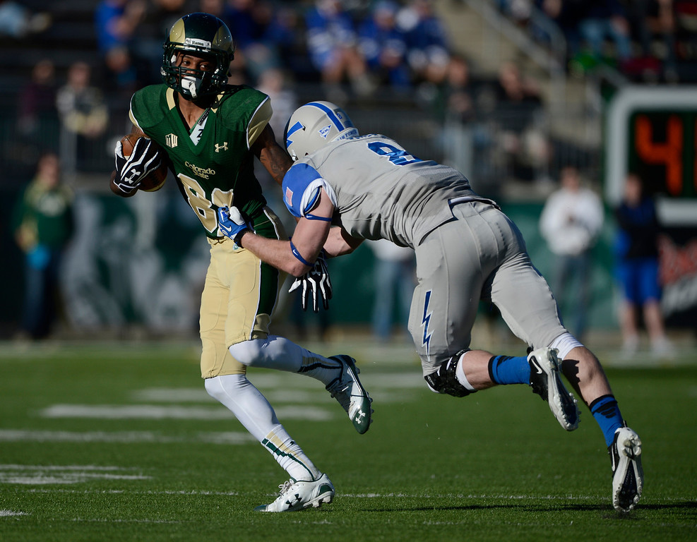 . Colorado State WR, Rashard Higgins, left, breaks free from Air Force DB, Jared Jones, right, in the third quarter at Hughes Stadium Saturday afternoon, November 30, 2013. The Rams went on to win 58-13. (Photo By Andy Cross/The Denver Post)