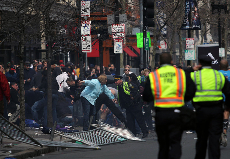 . In this photo provided by The Daily Free Press and Kenshin Okubo, people react to an explosion at the 2013 Boston Marathon in Boston, Monday, April 15, 2013. Two explosions shattered the euphoria of the Boston Marathon finish line on Monday, sending authorities out on the course to carry off the injured while the stragglers were rerouted away from the smoking site of the blasts. (AP Photo/The Daily Free Press, Kenshin Okubo)