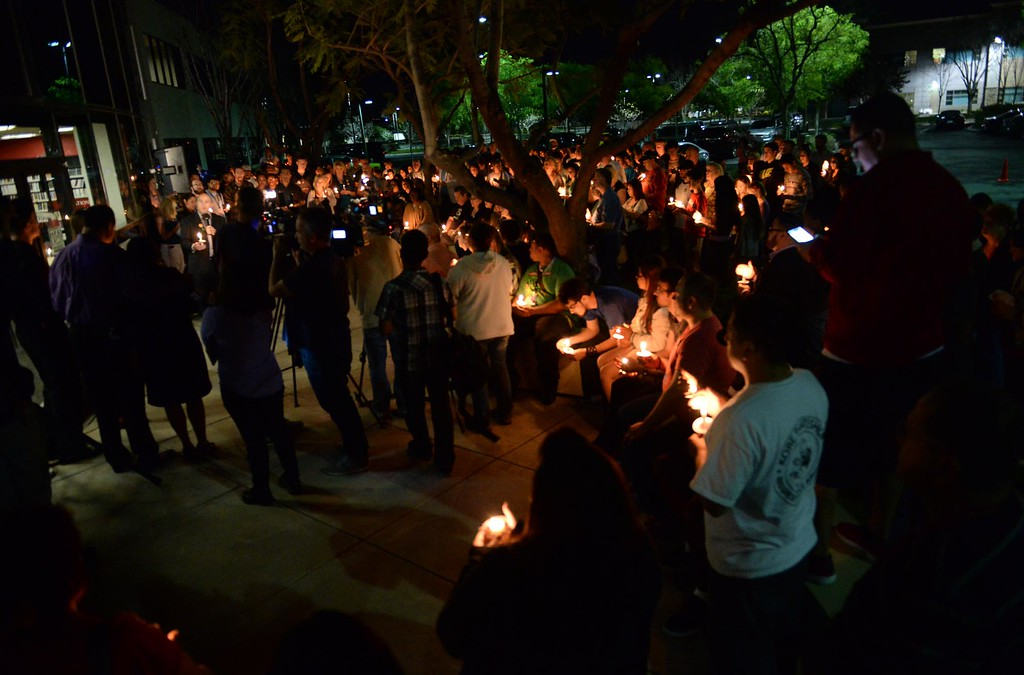 . A crowd gathers during a candlelight vigil for missing student, Sahray Barber, 22, on Friday, March 13, 2015 at the Art Institute of California Inland Empire in San Bernardino, Ca.  (Photo by Micah Escamilla/The Sun)
