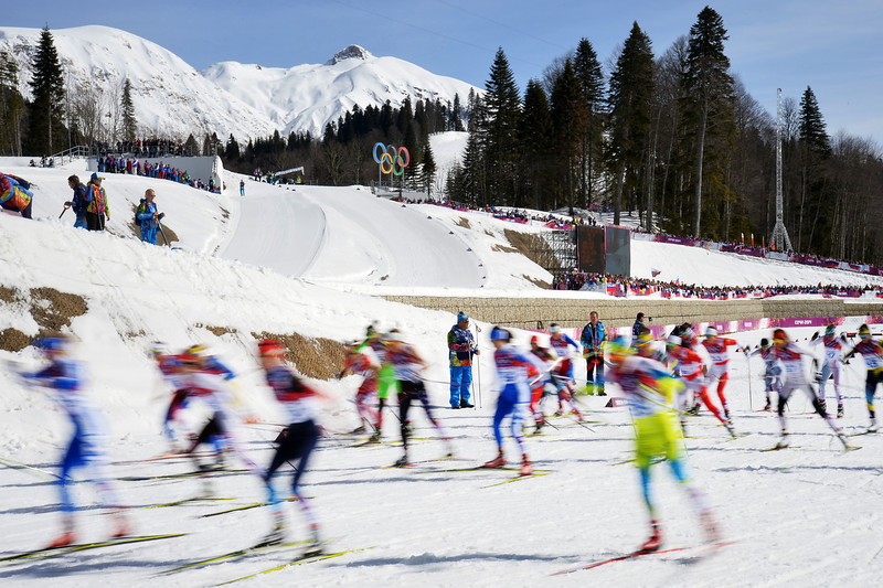 . Athletes compete at the start of the Women\'s Cross-Country Skiing 30km Mass Start Free at the Laura Cross-Country Ski and Biathlon Center during the Sochi Winter Olympics on February 22, 2014, in Rosa Khutor, near Sochi.  (ALBERTO PIZZOLI/AFP/Getty Images)
