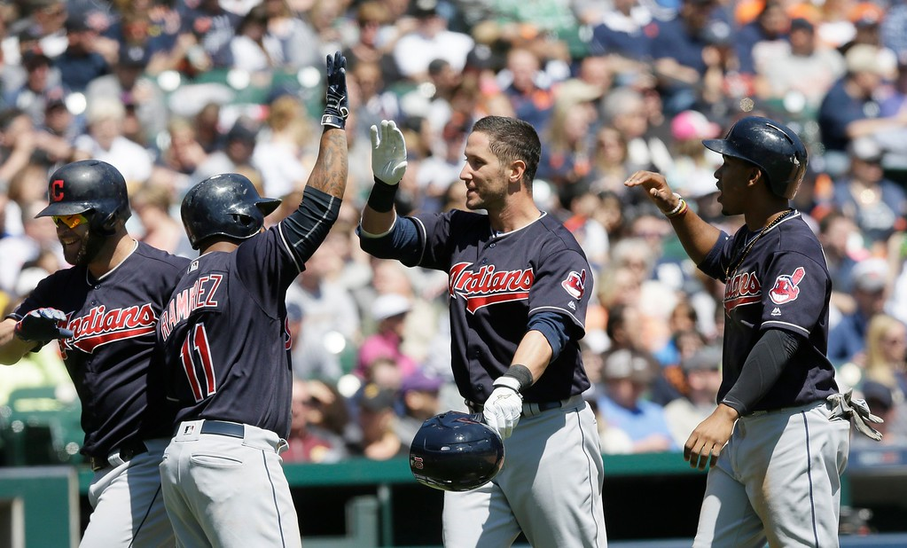 . Cleveland Indians\' Yan Gomes, center, greets Jose Ramirez (11) after his three-run home run during the third inning of a baseball game against the Detroit Tigers, Saturday, April 23, 2016, in Detroit. (AP Photo/Carlos Osorio)