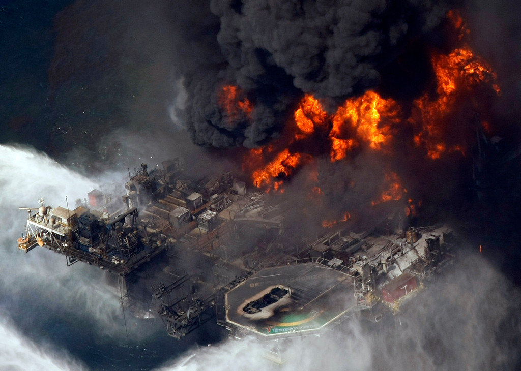 . FILE - In this April 21, 2010 file aerial photo taken in the Gulf of Mexico more than 50 miles southeast of Venice, La., the Deepwater Horizon oil rig is seen burning. The Gulf of Mexico oil spill began April 20th, 2010 and ended July 15, 2010 and is nation\'s worst offshore oil spill in history. (AP Photo/Gerald Herbert, File)