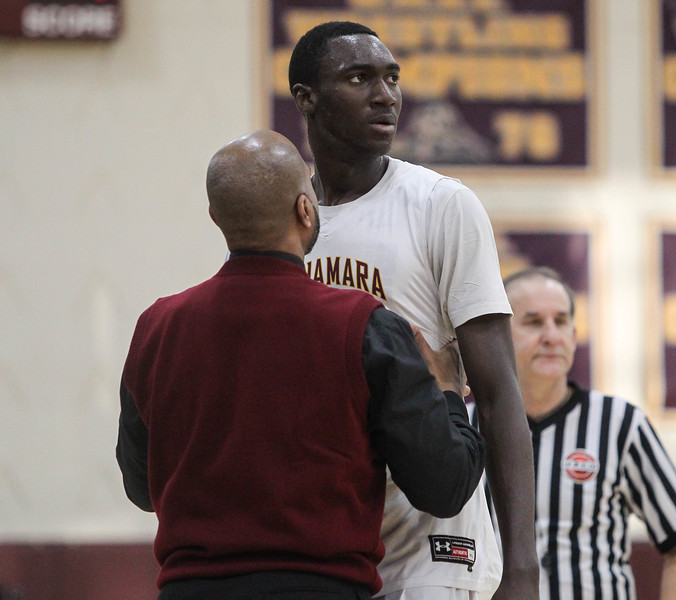 """February 2, 2019: McNamra head coach Keith Veney talks to center Favour Aire (11) after fouling out during HS boys basketball action between Bishop O'Connell HS and Bishop McNamara HS in Forestville. Photo by: Chris Thompkins/Prince George""""s Sentinel"""