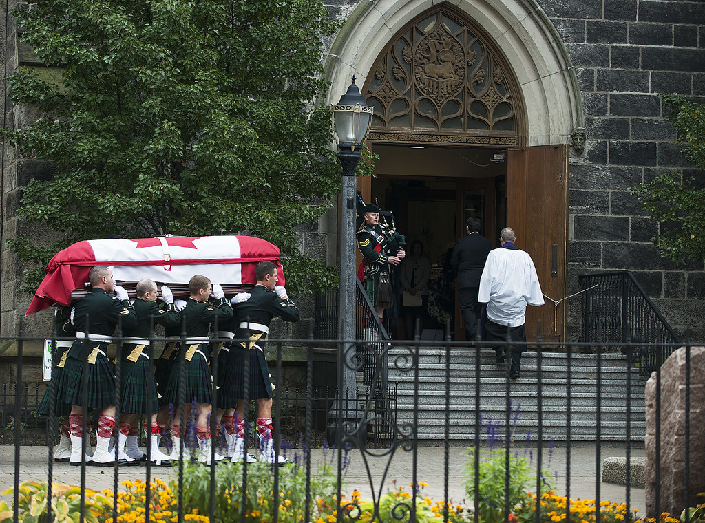 . The casket of Cpl. Nathan Cirillo is carried into The Christ\'s Church Cathedral during his funeral on October 28, 2014 in Hamilton, Ontario, Canada. Cpl. Nathan Cirillo was killed while on duty at Parliament Hill in Ottawa by Michael Zehaf-Bibeau on October 22.  (Photo by Aaron Vincent Elkaim/Getty Images)