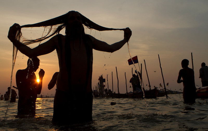 ". A Hindu devotee takes a holy bath at ""Sangam,\"" the meeting point of Indian holy rivers of Ganges, Yamuna and the mythical Saraswati, on occasion of \""Paush Purnima,\"" considered to be very auspicious according to Hindu calendars, during the Maha Kumbh festival in Allahabad, India, Sunday, Jan. 27, 2013. Hundreds of thousands of Hindu pilgrims are expected to take a ritual dip at Sangam on Sunday. Millions of Hindu pilgrims are likely to attend the Maha Kumbh festival, which is one of the world\'s largest religious gatherings that lasts 55 days and falls every 12 years. (AP Photo/Rajesh Kumar Singh)"