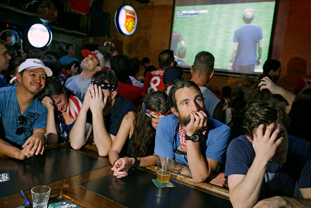 . U.S. soccer fans react as they watch their team lose to Belgium during a watch party at the Crown & Anchor British Pub Tuesday, July 1, 2014 in Las Vegas. (AP Photo/John Locher)