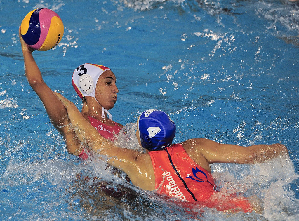 . Spain\'s Anna Aspar (L) vies with Netherlands\' Biurakn Hakhverdian (R) during their preliminary round match of the women\'s water polo competition at the FINA World Championships in Bernat Picornell pools in Barcelona on July 21, 2013.    JOSEP LAGO/AFP/Getty Images