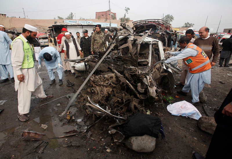 . Rescue workers collect body parts after a bomb attack at Fauji Market in Peshawar December 17, 2012. The blast in the market in northwest Pakistan on Monday killed at least 15 people, a security official said. The official said at least 20 people had been wounded in the blast in the market in the Khyber region, near the border with Afghanistan, and the death toll could rise.   REUTERS/Fayaz Aziz