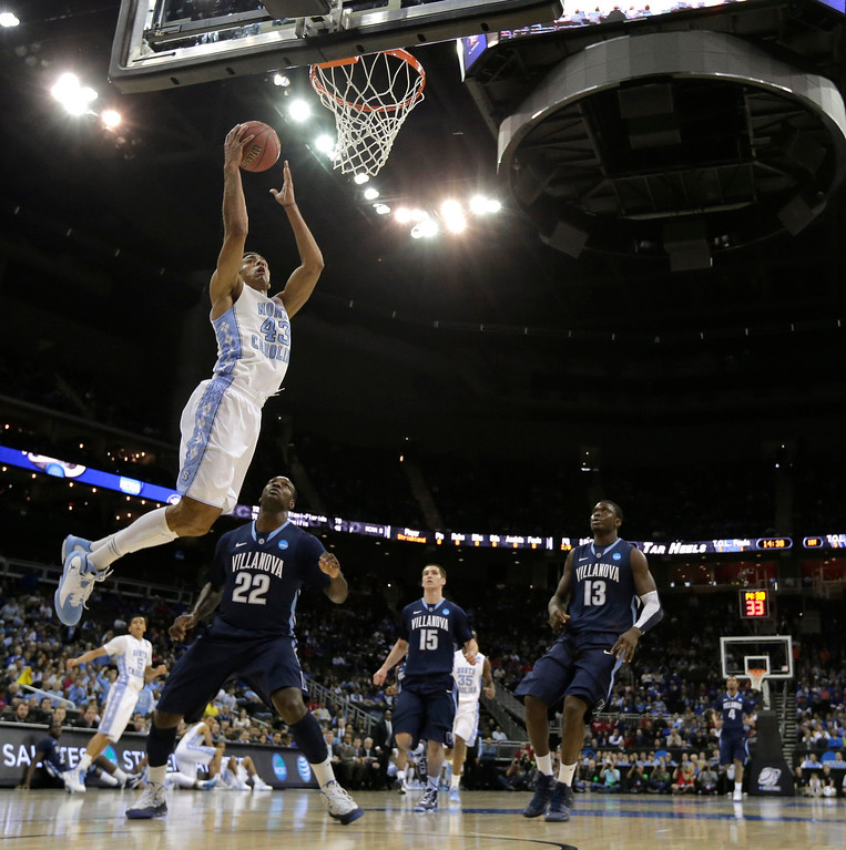 . North Carolina forward James Michael McAdoo (43) gets past Villanova forward JayVaughn Pinkston (22) to put up a shot during the first half of a second-round game in the NCAA college basketball tournament Friday, March 22, 2013, in Kansas City, Mo. (AP Photo/Charlie Riedel)