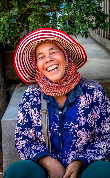 Happy vendor in a market.