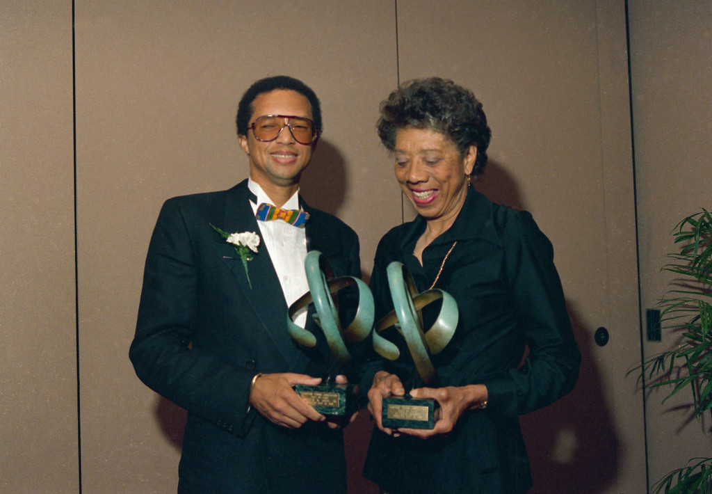 . Tennis players Arthur Ashe, left, and Althea Gibson pose while holding trophies after being inducted into the Eastern Tennis Association Hall of Fame, May 13, 1988 at the Marriott Marquis in New York.  (AP Photo/Susan Ragan)