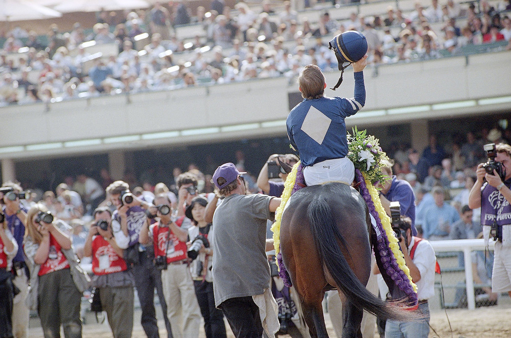 . Jockey Pat Day tips his hat to the crowd after winning the Breeders\' Cup Juvenile atop Favorite Trick at Hollywood Park in Inglewood, Calif. on Saturday, Nov. 8, 1997. (AP Photo/Reed Saxon)