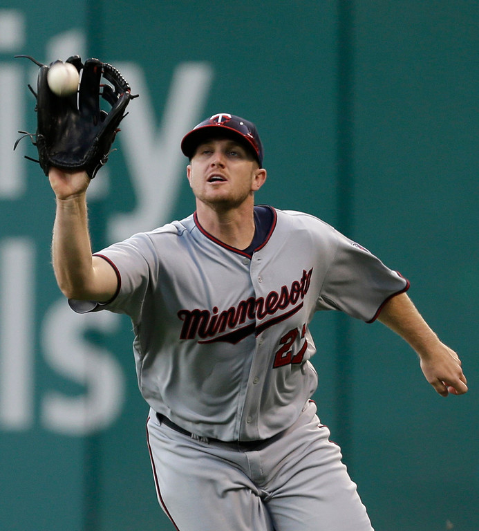 . Minnesota Twins\' Chris Parmelee catches a fly ball hit by Cleveland Indians\' Carlos Santana in the third inning. (AP Photo/Tony Dejak)