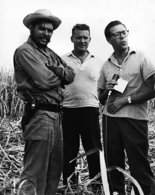 . Major Ernesto (Che) Guevara (left) is seen during an interview with Knowlton Nash (right), CBC Washington correspondent in Cuba February 1963. Donald Cameron is supervising editor of CBC Newsmagazine, a weekly Canadian Broadcasting Corp TV news program. Guevara, Cuban Minister of Industry was in a sugar cane field in central Cuba inspecting a new machine used for cutting the cane. The interview was conducted through an interpreter. (AP Photo)