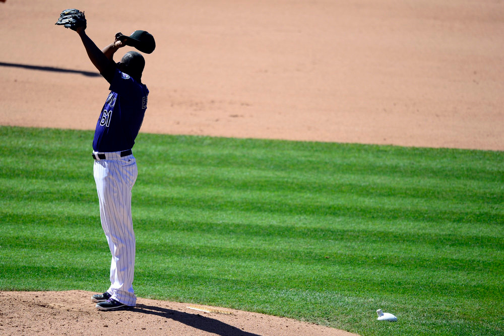 . Colorado Rockies relief pitcher Edgmer Escalona (61) reacts to his collapse in the seventh inning against the San Diego Padres during the action in Denver. The Colorado Rockies hosted the San Diego Padres at Coors Field on Sunday, June 9, 2013. (Photo by AAron Ontiveroz/The Denver Post)