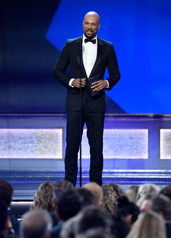 . Common presents the award for best song at the 22nd annual Critics\' Choice Awards at the Barker Hangar on Sunday, Dec. 11, 2016, in Santa Monica, Calif. (Photo by Chris Pizzello/Invision/AP)