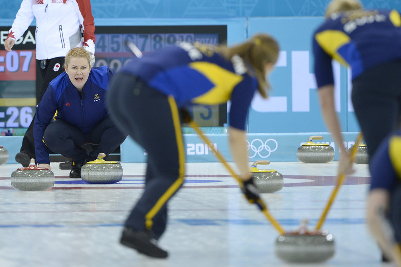 . Sweden\'s Margaretha Sigfridsson (L) watches the stone during the Women\'s Curling Gold Medal Game Sweden vs Canada at the Ice Cube Curling Center during the Sochi Winter Olympics on February 20, 2014.  JONATHAN NACKSTRAND/AFP/Getty Images
