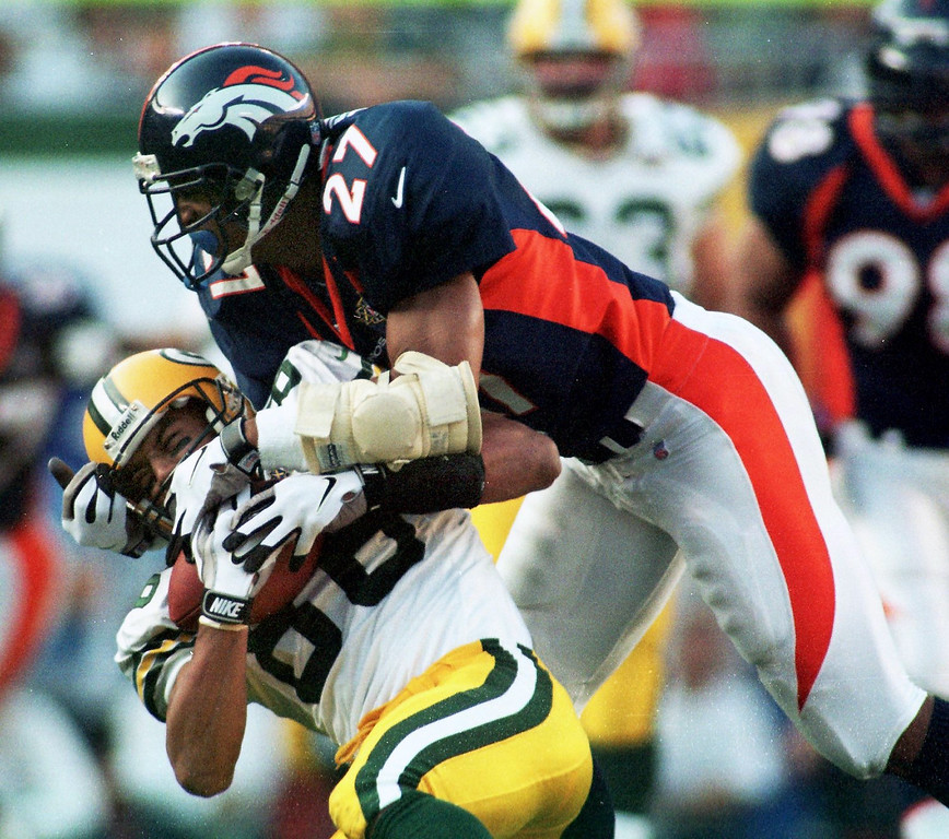 . Caption: Denver Broncos Steve Atwater takes down Green Bay  Packers Antonio Freeman during the first quarter of Super Bowl  XXXII. (John Leyba/The Denver Post)