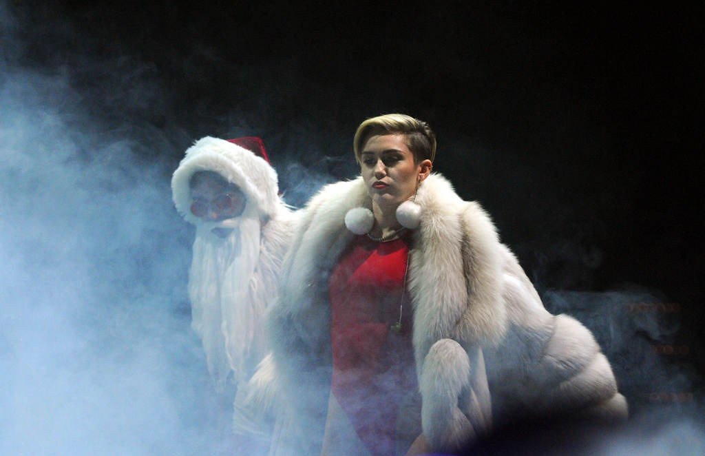 ". Miley Cyrus enters the stage and as the band begins to play ""Party in the USA\"" at Xcel Energy Center in St. Paul, Tuesday, December 10, 2013. (Pioneer Press: Chris Polydoroff)"