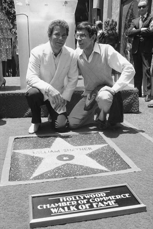. William Shatner, left, shares the moment with longtime friend and fellow actor Leonard Nimoy during ceremony in Hollywood, Los Angeles on Thursday, May 19, 1983 honoring Shatner with a star the 1,762nd along the Hollywood Walk o Fame. (AP Photo/Reed Saxon)