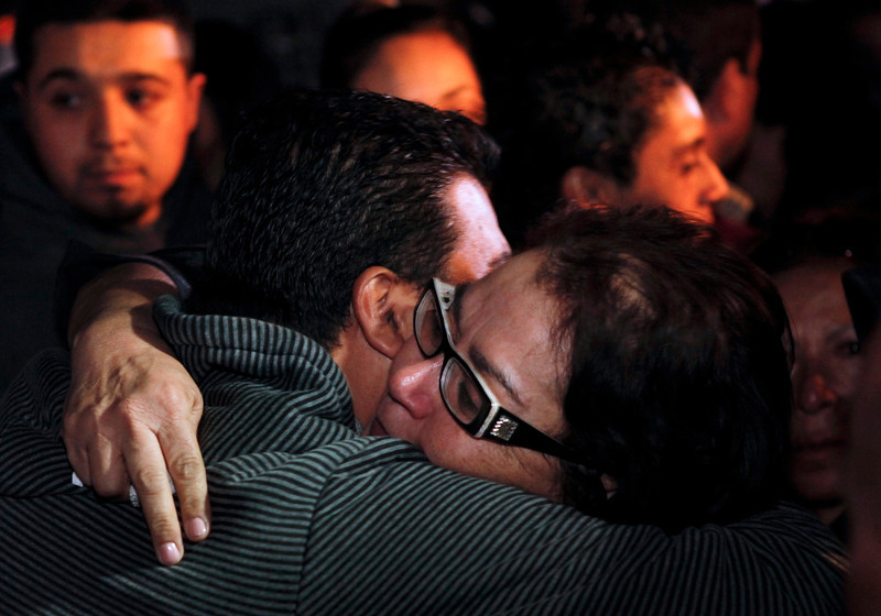 . Rosa Rivera, mother of singer Jenni Rivera, hugs a family member after a news conference outside the home of Rivera\'s father in Lakewood, Calif., on Sunday, Dec. 9, 2012. Authorities have not confirmed her death, but Riveraís relatives in the U.S. say they have few doubts that she was on the Learjet 25 that disintegrated on impact Sunday in rugged territory in Nuevo Leon state in northern Mexico. (AP Photo/Patrick T. Fallon)