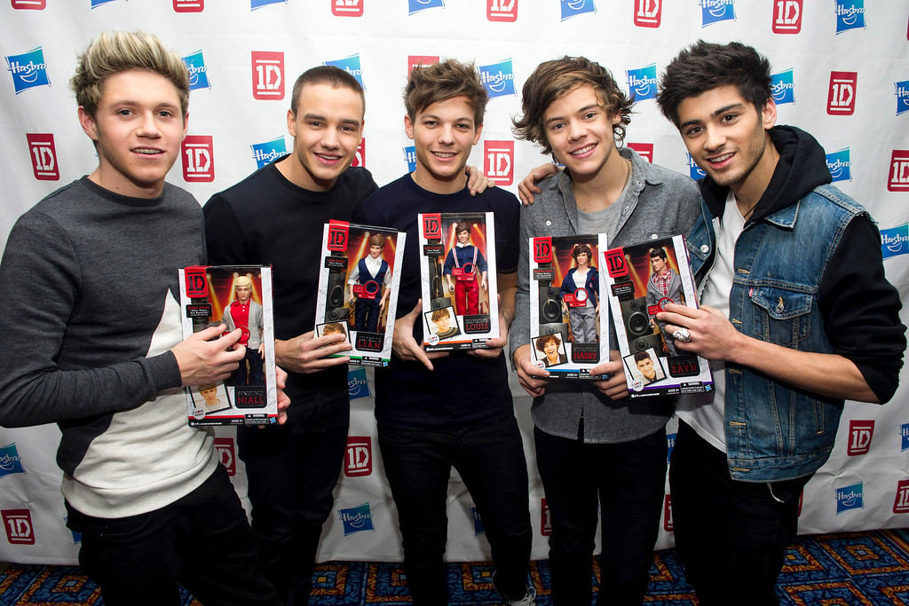 . Members of worldwide musical sensation One Direction, from left, Niall Horan, Liam Payne, Louis Tomlinson, Harry Styles and Zayn Malik pose with their Hasbro dolls at a press event on Monday, Nov. 26, 2012 in New York. (Photo by Charles Sykes/Invision for Hasbro/AP Images)