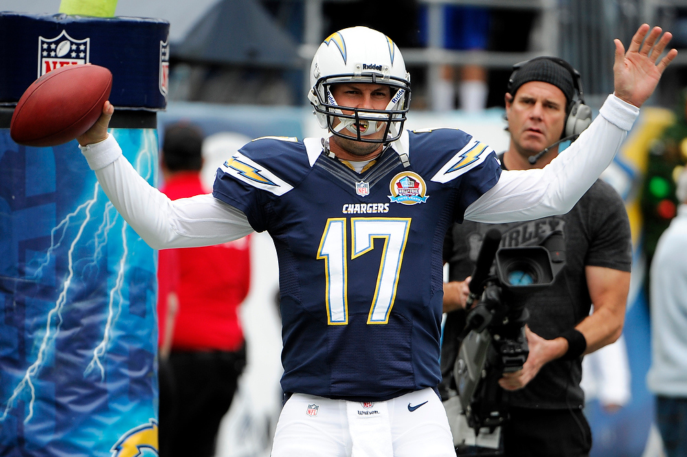 Description of . San Diego Chargers quarterback Philip Rivers warms up before an NFL football game against the Carolina Panthers, Sunday, Dec. 16, 2012, in San Diego. (AP Photo/Denis Poroy)