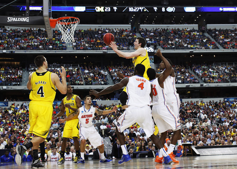 . Nik Stauskas #11 of the Michigan Wolverines shoots over the Florida Gators in the first half during the South Regional Round Final of the 2013 NCAA Men\'s Basketball Tournament at Dallas Cowboys Stadium on March 31, 2013 in Arlington, Texas.  (Photo by Tom Pennington/Getty Images)
