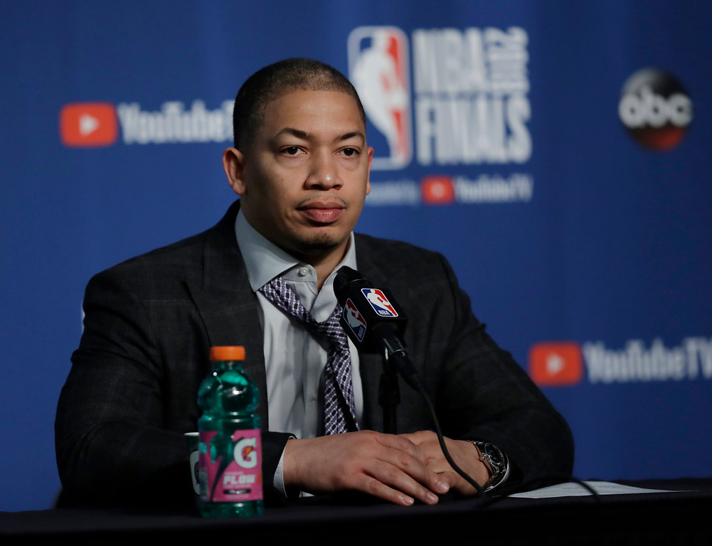 . Cleveland Cavaliers coach Tyronn Lue listens during a news conference following Game 3 of basketball\'s NBA Finals, Wednesday, June 6, 2018, in Cleveland. The Golden State Warriors defeated the Cavaliers 110-102 to take a 3-0 lead in the series. (AP Photo/Tony Dejak)