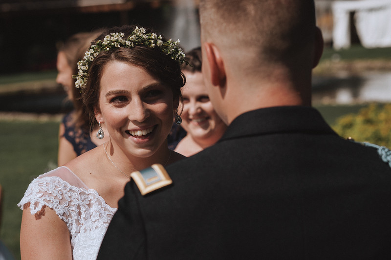 Bride smiling as she looks up into her grooms eyes.