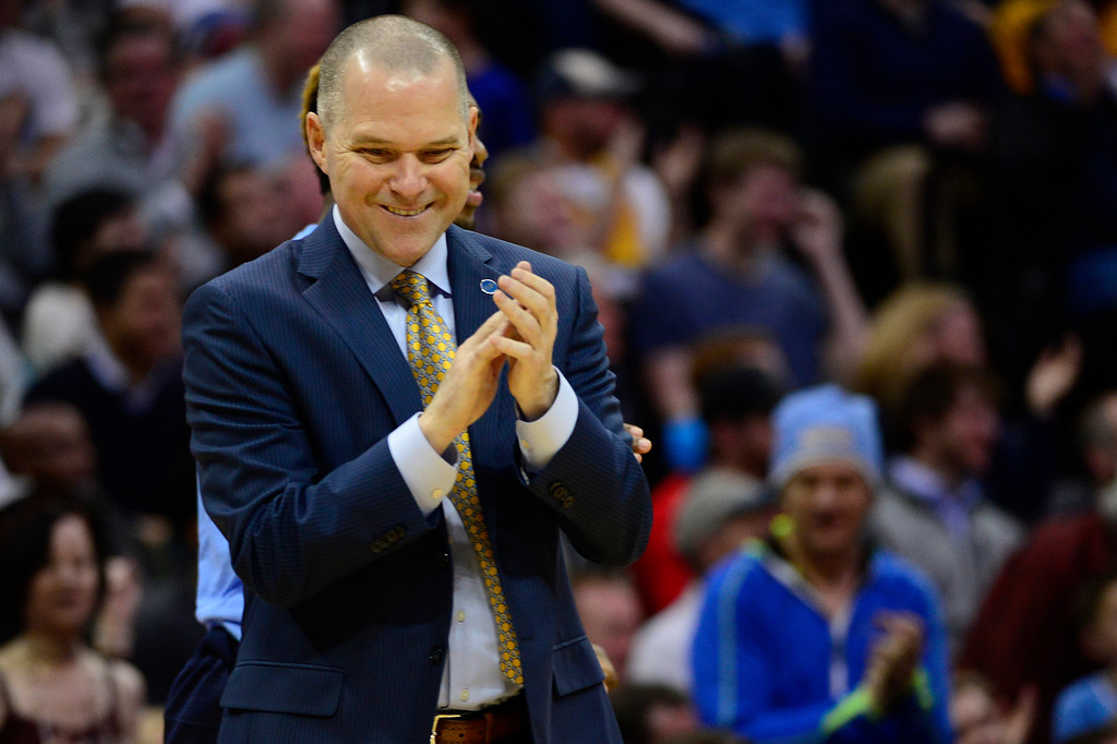 . DENVER, CO - JANUARY 13: Michael Malone of the Denver Nuggets claps after his team takes the lead during the second half at the Pepsi Center on January 13, 2016 in Denver, Colorado. The Nuggets defeated the Warriors 112-110, giving the Warriors their third loss of the season. (Photo by Brent Lewis/The Denver Post)