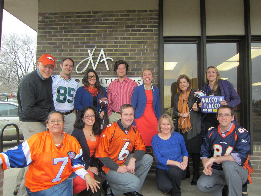 . JVA Consulting geared up for the big Broncos game by sporting their favorite NFL gear and colors to work Friday, January 11. Amber Alarid