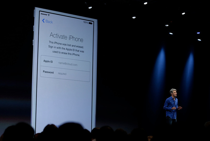 . Craig Federighi, senior vice president of Software Engineering at Apple demonstrates the new activation lock security feature in iOS 7 during the keynote address of the Apple Worldwide Developers Conference Monday, June 10, 2013 in San Francisco. (AP Photo/Eric Risberg)