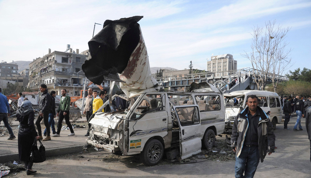 Description of . A general view of the destruction after an explosion in central Damascus February 21, 2013, in this handout photograph released by Syria's national news agency SANA. A car bomb killed 53 people and wounded 200 in central Damascus on Thursday when it blew up on a busy highway close to ruling Baath Party offices and the Russian Embassy, Syrian television said. REUTERS/Sana