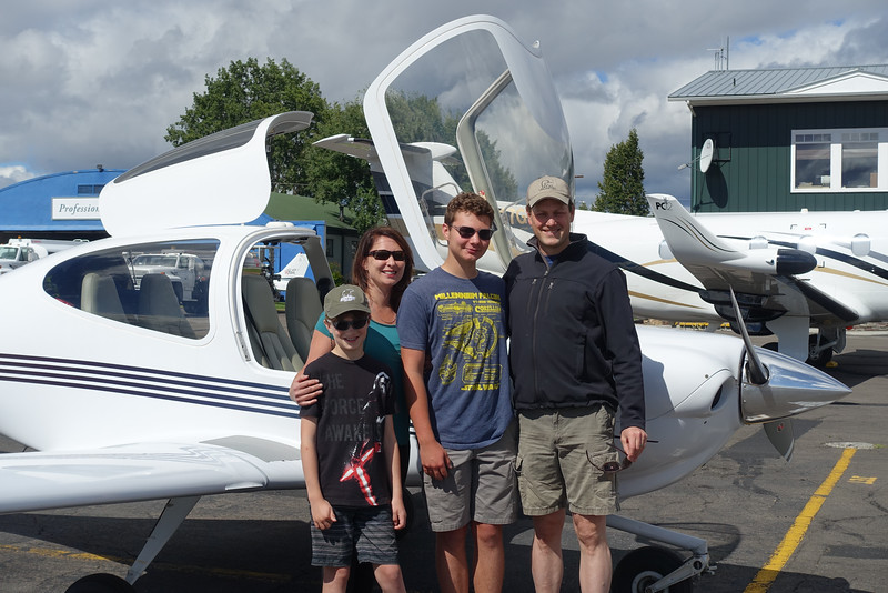 Graham family pose next to the trusty Diamond DA-40 trainer aircraft Steve rented for picking them up.