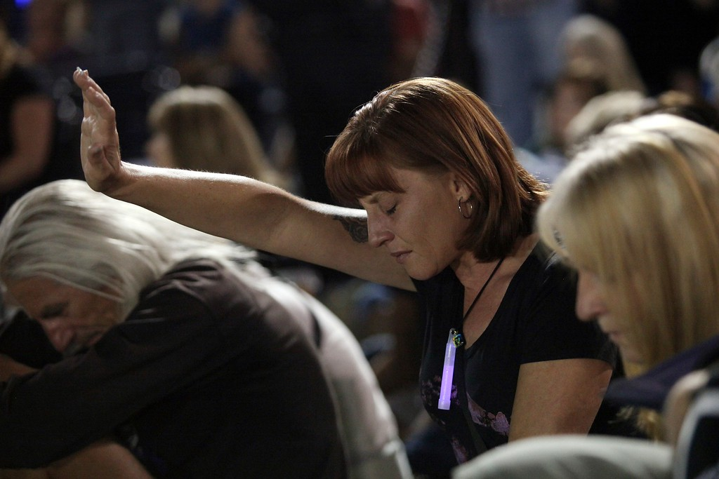 . A woman prays during a vigil and memorial gathering at the Prescott High School in Prescott, Arizona on July 2, 2013.  AFP PHOTO / KRISTA  Kennell/AFP/Getty Images