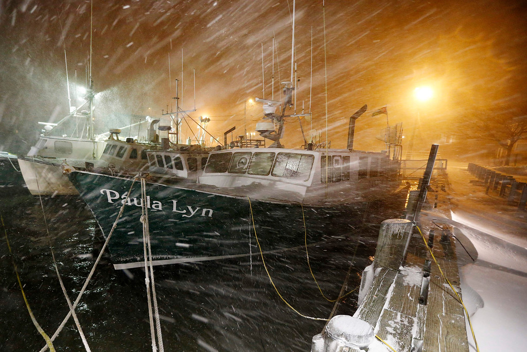 . Fishing boats ride out the storm at dock in Scituate, Mass., Tuesday, Jan. 27, 2015. The winter storm packing blizzard conditions spun up the East Coast early Tuesday, pounding parts of coastal New Jersey northward through Maine with high winds and heavy snow. (AP Photo/Michael Dwyer)