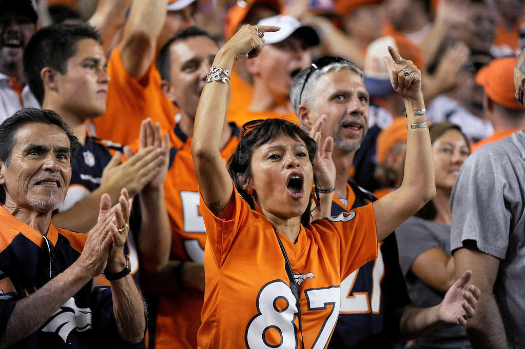 . Denver Broncos fans cheer a touchdown during the third quarter. Denver Broncos vs Baltimore Ravens September 5, 2013 at Sports Authority at Mile High. (Photo by Tim Rasmussen/The Denver Post) /The Denver Post)