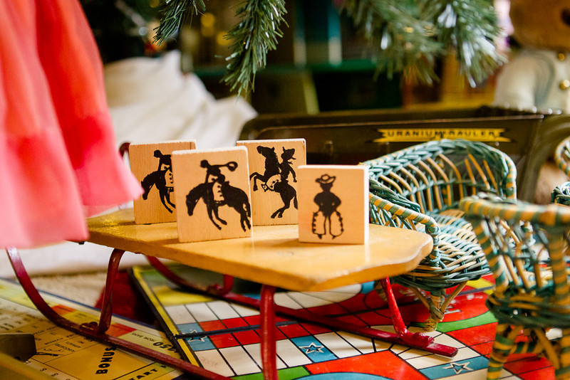 . Tiny cowboy tiles, wicker furniture, a tiny sled and tiny game boards, part of the Denver Museum of Miniatures, Dolls and Toys\' contribution to the Governor\'s mansion holiday decor. Photo by Mark Broste
