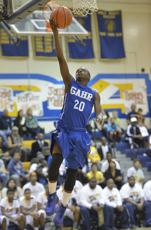 . LONG BEACH, CALIF. USA -- Gahr\'s Jeremy Carlyle (20) takes a shot against Millikan during their CIF-SS Divison 1-A playoff game in Long Beach on February 15, 2013. Millikan defeated Gahr, 74 to 64. Photo by Jeff Gritchen / Los Angeles Newspaper Group