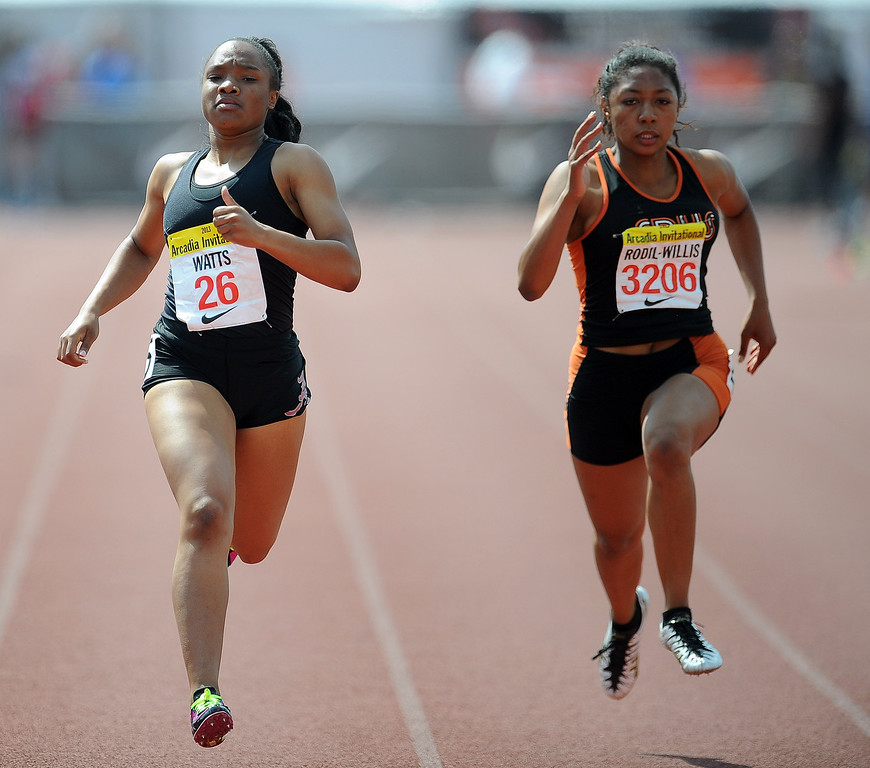 . Alemany\'s Asia Watts, left, along with South Pasadena\'s Kamia Rodil Willis competes in the 200 meters race in the during the Arcadia Invitational at Arcadia High School on Saturday, April 6, 2013 in Arcadia, Calif.  (Keith Birmingham Pasadena Star-News)