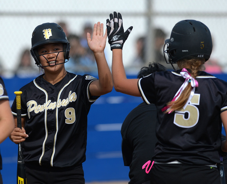 . Peninsula\'s Kristyne Hong (9) and Brooke Christensen (5) celebrate as they start the scoring against North in a first round CIF SS Division III softball game Thursday in Torrance. Peninsula won 4-1. 20130516 Photo by Steve McCrank / Staff Photographer