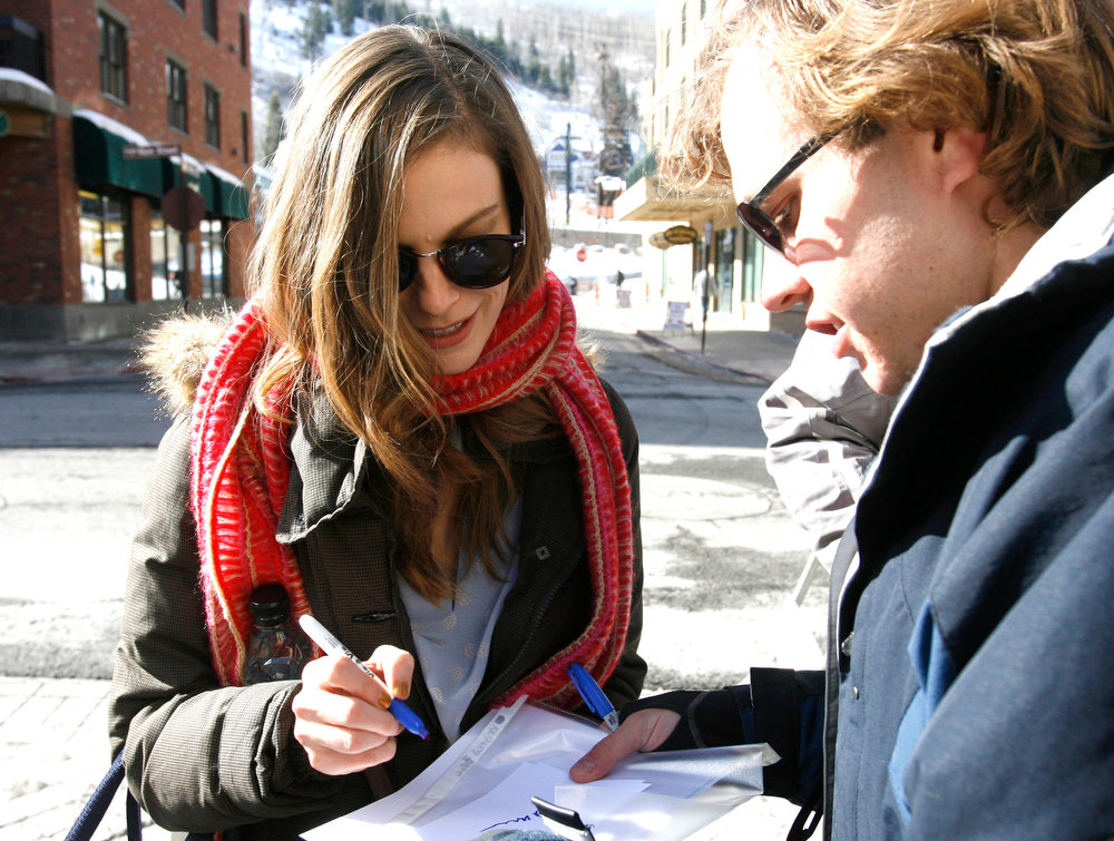 Description of . Rick Egan  | The Salt Lake Tribune   Lindsay Burdge, signs autographs on Main Street in Park City, Sunday, January 20, 2013.