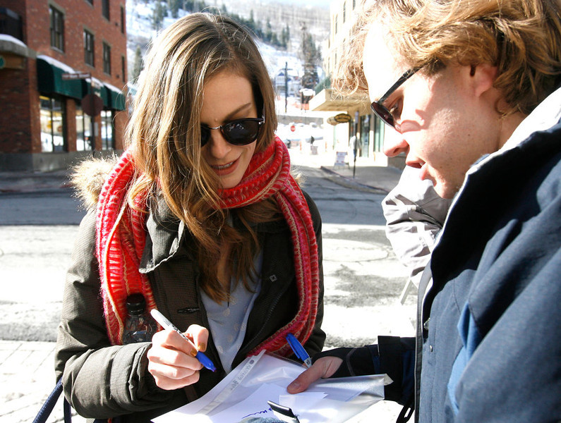 . Rick Egan  | The Salt Lake Tribune   Lindsay Burdge, signs autographs on Main Street in Park City, Sunday, January 20, 2013.