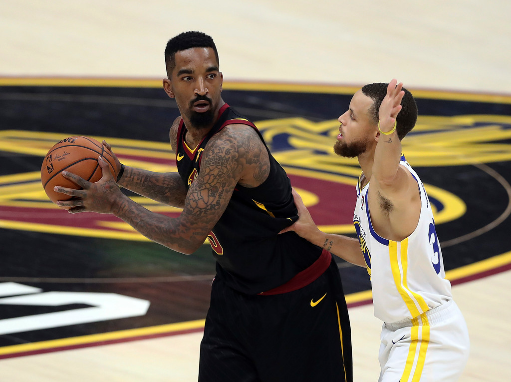 . Cleveland Cavaliers\' JR Smith id defended by Golden State Warriors\' Stephen Curry during the first half of Game 4 of basketball\'s NBA Finals, Friday, June 8, 2018, in Cleveland. (AP Photo/Carlos Osorio)