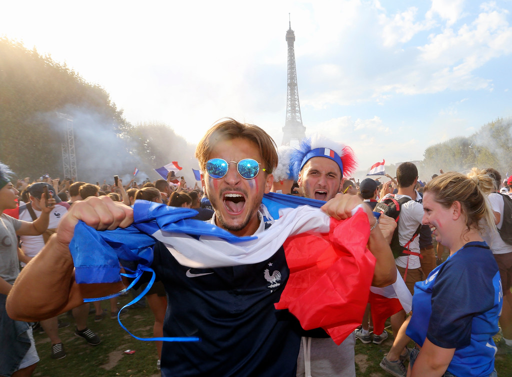 . Supporters of the French soccer team celebrate after France won the World Cup final between France and Croatia, Sunday, July 15, 2018 on the Champ de Mars in Paris. France won its second World Cup title by beating Croatia 4-2 . (AP Photo/Bob Edme)