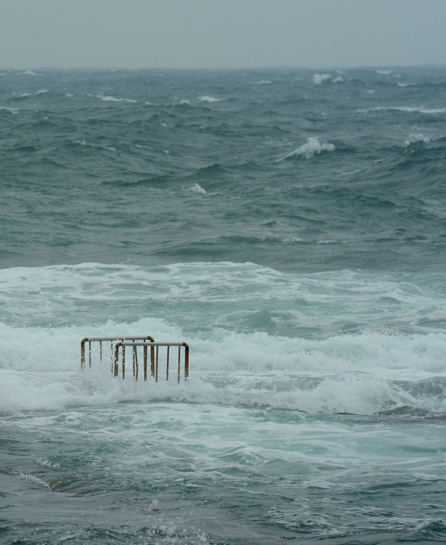 . Sea waves cover the ladder bars (L) from a swimming pool at Hoping island, in Keelung, northern Taiwan as typhoon Fitow approaches on October 5, 2013.  Taiwan on October 5 issued a warning over Typhoon Fitow as it approached the island\'s north with threats of torrential rains and powerful winds over the weekend.    SAM YEH/AFP/Getty Images